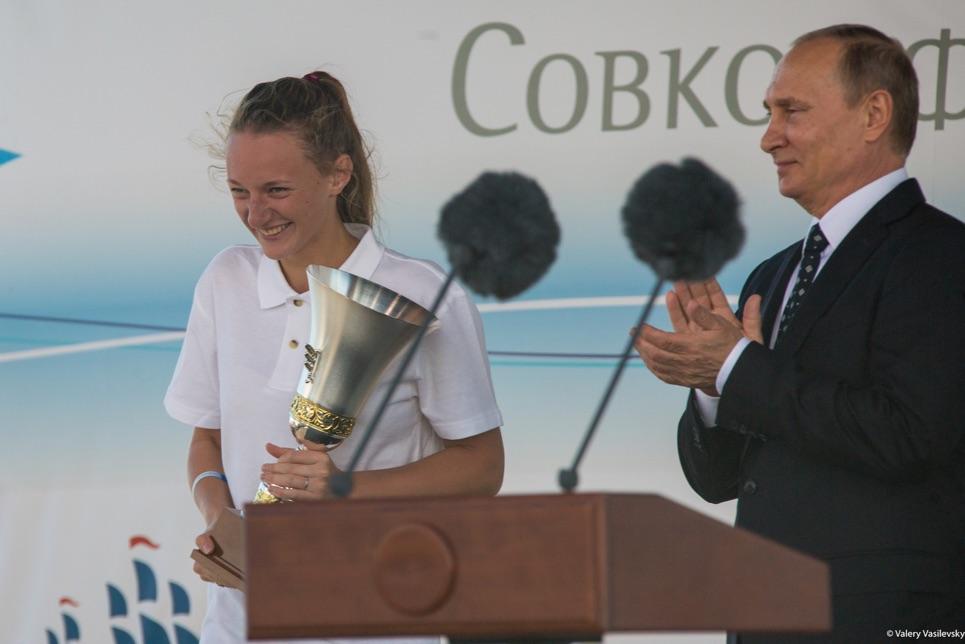 Vladimir Putin giving out prizes