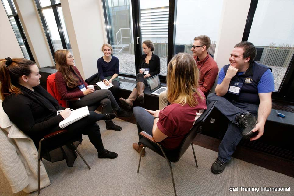 Deep in discussion during a break out session
