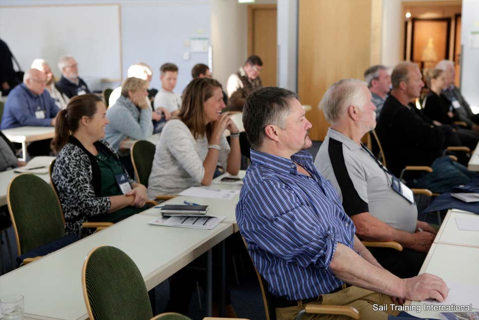 Delegates engaged in a session