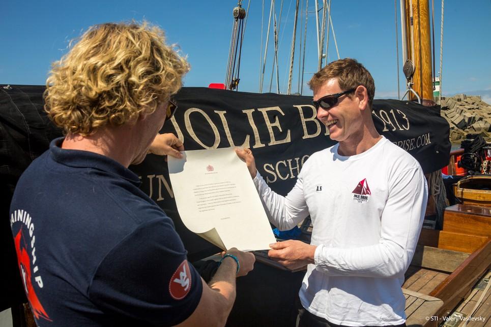Wylde Swan handing over the Queen's letter to Jolie Brise