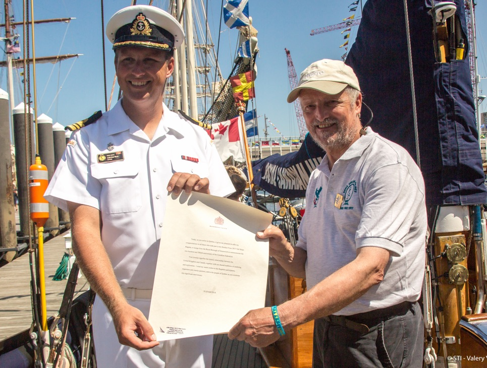 Captain Mike Willis of Oriole hands over the royal letter to Captain Andy Hunter of Rona ii